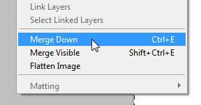 use the merge down command to merge two layers in photoshop cs5